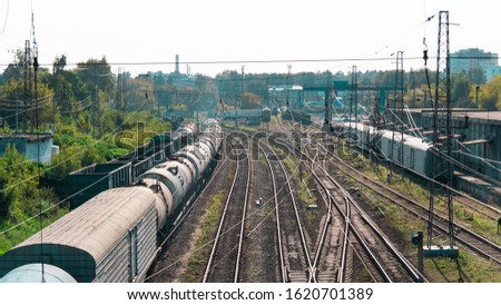 Freight train wagons. Transportation station. Transport industry background. Freight trains with gondola cars, tanks and a refrigerator car for transporting goods by rail. Business logistics,import.  #1620701389
