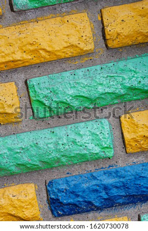 Decorative brick texture background. Stock photo multi-colored brick. Decorative brick poured out of forms. #1620730078