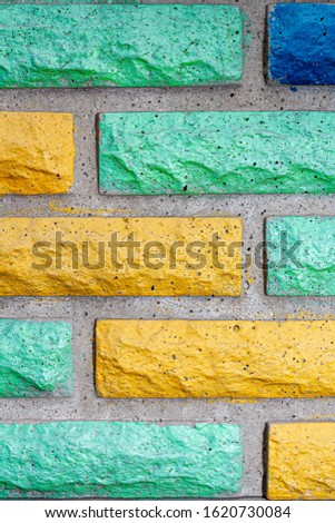 Decorative brick texture background. Stock photo multi-colored brick. Decorative brick poured out of forms. #1620730084