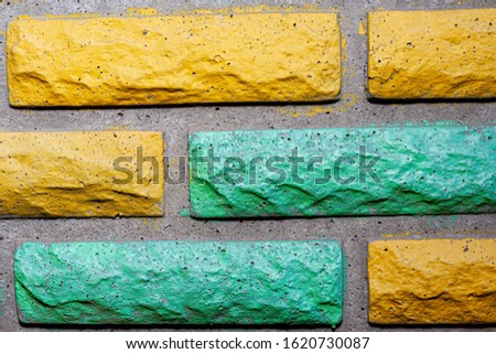Decorative brick texture background. Stock photo multi-colored brick. Decorative brick poured out of forms. #1620730087