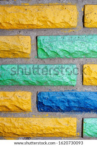 Decorative brick texture background. Stock photo multi-colored brick. Decorative brick poured out of forms. #1620730093