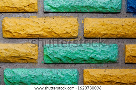 Decorative brick texture background. Stock photo multi-colored brick. Decorative brick poured out of forms. #1620730096