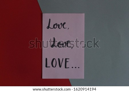 """Love love love"" handwritten on pink paper about art composition on colored papers gray and red #1620914194"