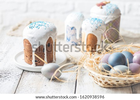 Easter table with Easter cakes and Easter eggs over white background #1620938596