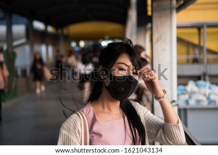 Asian woman wearing protection mask for prevent air pollution, Dust PM 2.5. Problems found in major cities around the world. air pollution, Environmental pollution concept #1621043134