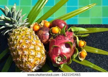 Tropical fruits on the pool. Delicious exotic fruit in the resort. A tropical delicacy. The fresh bite of the sea. Vacation in the tropics. Hotel all inclusive. A healthy Breakfast in Thailand #1621141465