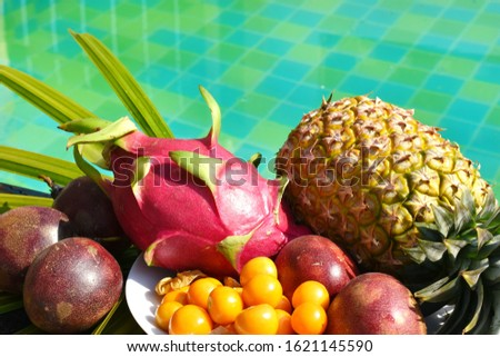 Tropical fruits on the pool. Delicious exotic fruit in the resort. A tropical delicacy. The fresh bite of the sea. Vacation in the tropics. Hotel all inclusive. A healthy Breakfast in Thailand #1621145590