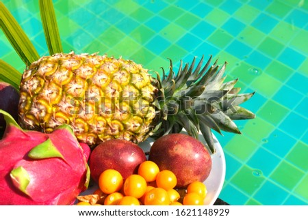Tropical fruits on the pool. Delicious exotic fruit in the resort. A tropical delicacy. The fresh bite of the sea. Vacation in the tropics. Hotel all inclusive. A healthy Breakfast in Thailand #1621148929