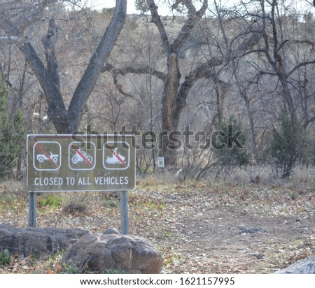 Closed to vehicles, motorcycles and snowmobiles sign at Clear Creek Campground in Coconino National Forest. Yavapai County, Arizona USA