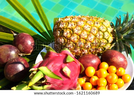 Tropical fruits on the pool. Delicious exotic fruit in the resort. A tropical delicacy. The fresh bite of the sea. Vacation in the tropics. Hotel all inclusive. A healthy Breakfast in Thailand #1621160689