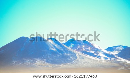 Bolivian Volcano and Mountain Range With Thin Atmospheric Layer Above Plains #1621197460
