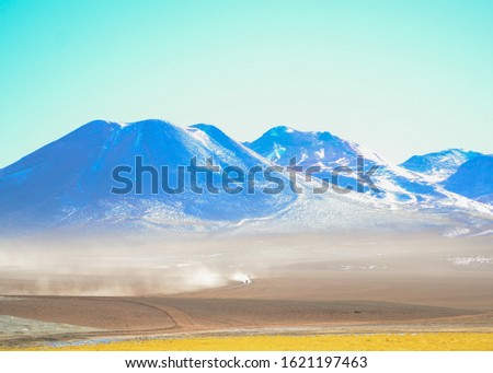 Bolivian Volcano and Mountain Range With Thin Atmospheric Layer Above Plains #1621197463