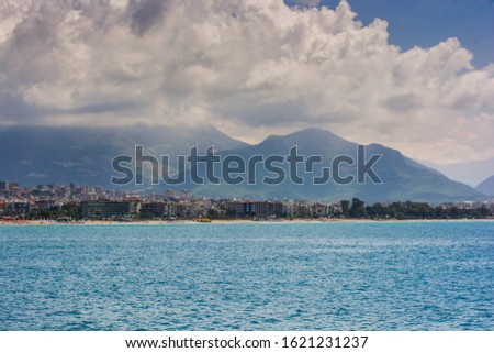 Concept of leisure and resorts. Great aerial view on sea resort, clear blur wather, beach, mountains and coastline with hotels. #1621231237