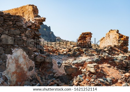 Close up of remains of the destroyed house. Brick rubble, stone and concrete rubble. Royalty-Free Stock Photo #1621252114
