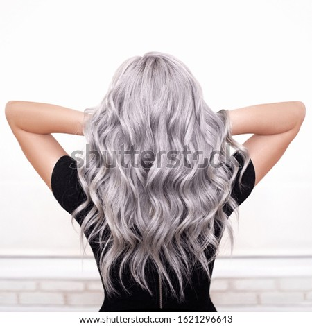 beautiful girl back with grey silver ash blonde wavy hair isolated Royalty-Free Stock Photo #1621296643