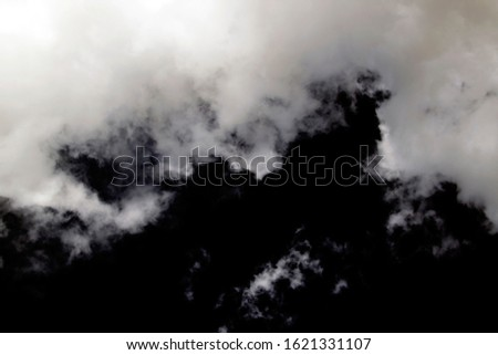 White and gray clouds against the black sky. Cloudy sky background.  Cloudy weather. #1621331107