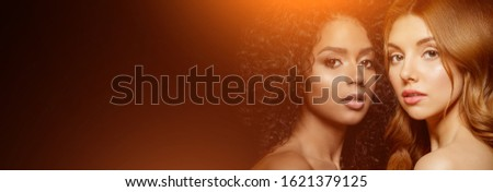 Multi-ethnic beauty. Caucasian and African. Different ethnicity women on black background. Beautiful vogue girls. #1621379125
