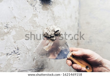 Manual builder with wall stucco repairing a house. Construction finishing work, wall decoration Royalty-Free Stock Photo #1621469158