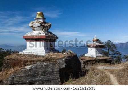 Buddhist stupas on the trail. White tibetan pagodas on PK (Pikey) peak trek in Nepal. Trekking in Nepal. #1621612633