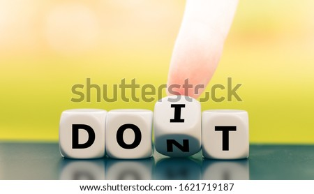 """Hand turns a dice and changes the expression """"don't"""" to """"do it"""". #1621719187"""