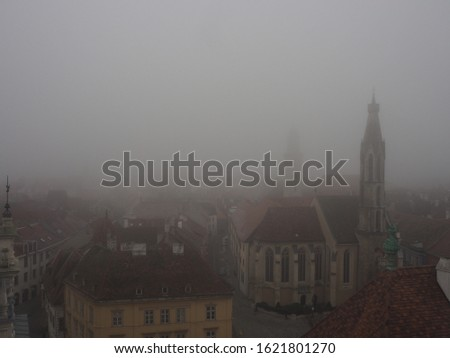 The town is covered by fog, pollution, and dust. Polluting atmosphere/Polluted air. #1621801270