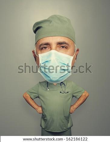 bighead surgeon in mask over grey background