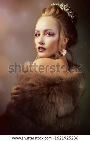 Luxurious girl with a beautiful make-up in a fur coat. Beauty in furs. Model on a bokeh background. Young beautiful woman. #1621925236