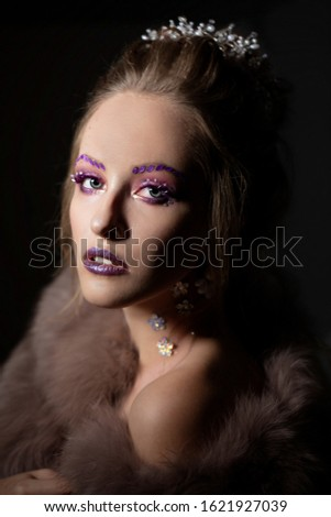 Luxurious girl with a beautiful make-up in a fur coat. Beauty in furs. Model on a dark background. Young beautiful woman. #1621927039