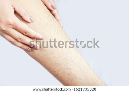 closeup woman with hairy, unshaven hair leg