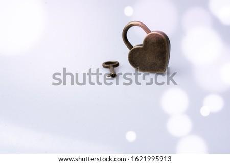 Metal padlock in heart shape as  symbol of love #1621995913