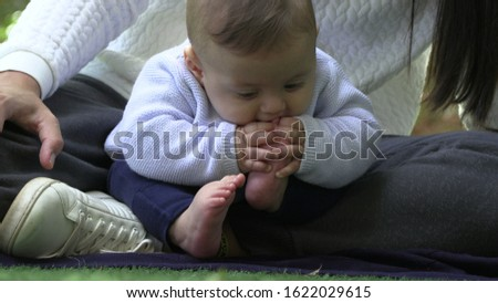Baby putting foot in mouth infant puts feet in mouth2 #1622029615
