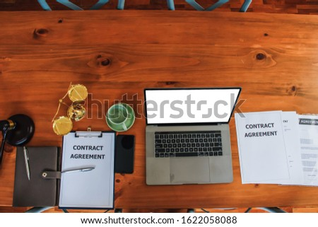 The contract that is prepared on the table in the office of the real estate manager is a contract that is given to the hire-purchase company, signing a contract to accept the installment payment. #1622058088