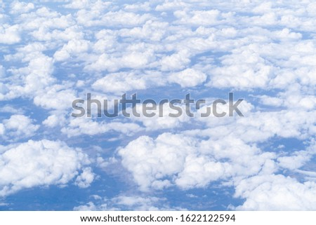 Above view of cloudscape from airplane #1622122594