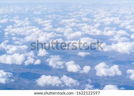 Above view of cloudscape from airplane #1622122597
