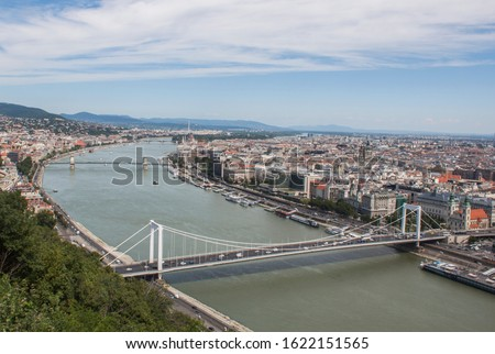 Elizabeth bridge and Chain bridge and the downtown of Budapest, Hungary, Europe from above. Rooftop view with buildings, church towers and colorful rooftops. European capital city skyline. #1622151565