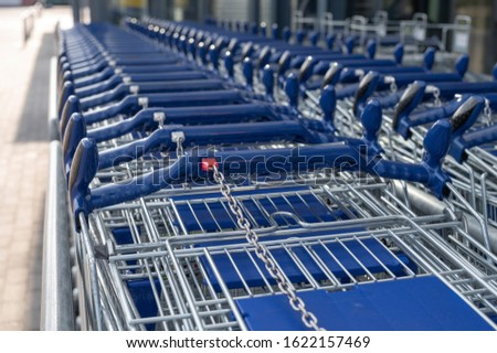 Shopping trolleys pushed into each other #1622157469