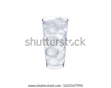 Clear glass with clear carbonated liquid and ice cubes #1622167996