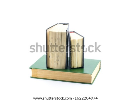Books stand upright with pages slightly open. White background. #1622204974