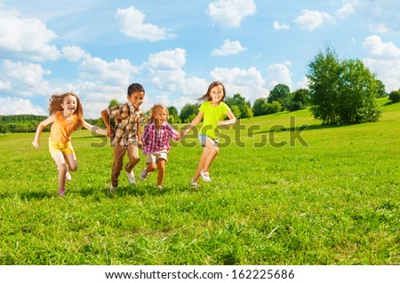 Kids running in the park together 6 and 7 years old, diversity looking, boys and girls running together  #162225686