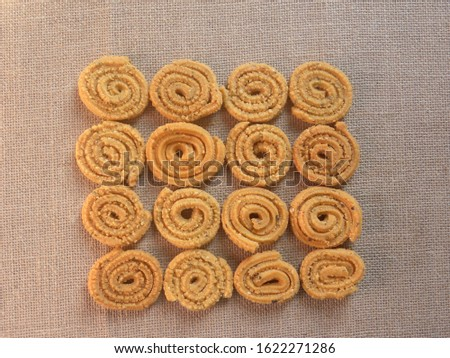 Brown deep fried Chakli Indian savory snack #1622271286
