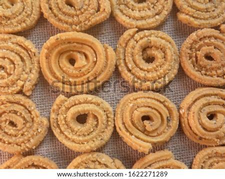 Brown deep fried Chakli Indian savory snack #1622271289