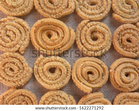 Brown deep fried Chakli Indian savory snack #1622271292