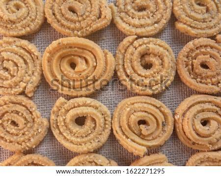 Brown deep fried Chakli Indian savory snack #1622271295