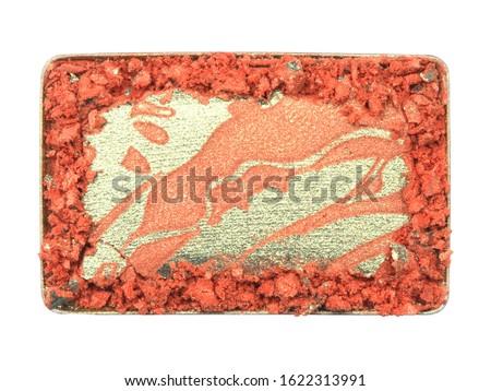 Rectangular box of dry crushed orange eyeshadow as sample of cosmetic product isolated on white background #1622313991