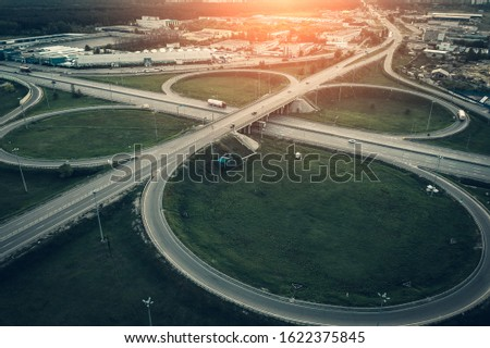 Aerial view of suburban highway interchange or intersection, roads and highways. #1622375845