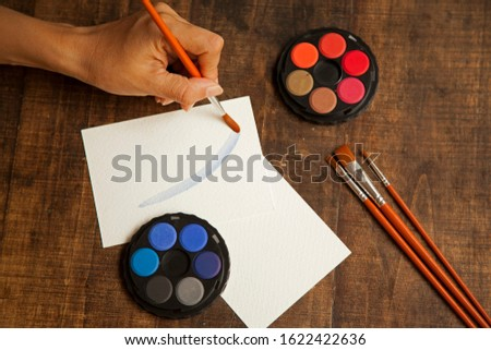 blank sheet on the table with paintbrushes and watercolor #1622422636
