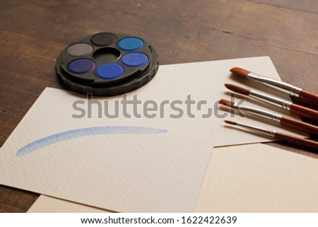 blank sheet on the table with paintbrushes and watercolor #1622422639