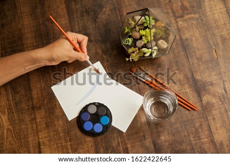 blank sheet on the table with paintbrushes and watercolor #1622422645
