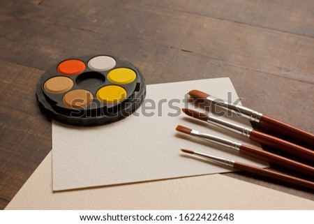 blank sheet on the table with paintbrushes and watercolor #1622422648