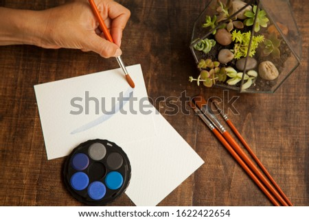 blank sheet on the table with paintbrushes and watercolor #1622422654